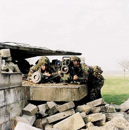 Two soldiers constructing a firing post