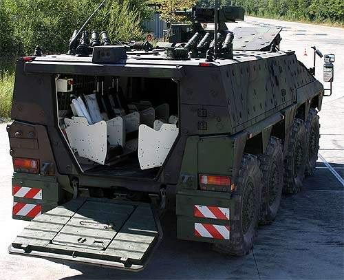Boxer vehicle with the rear doors open showing its troop transport area.