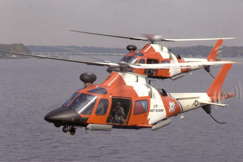 A109 Power helicopters in service with the US Coastguard. The A109s' role is to interdict high-speed smuggling vessels and they are armed with machine guns.
