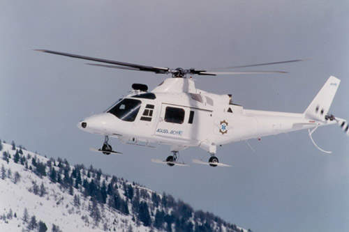 A109 ambulance rescue  helicopter in operation in the mountains of Switzerland
