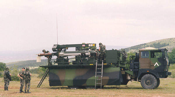 Troops loading missiles onto a CL-289 reconnaissance UAV vehicle