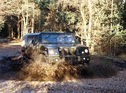 The Panther Command and Liaison Vehicle splashed through mud