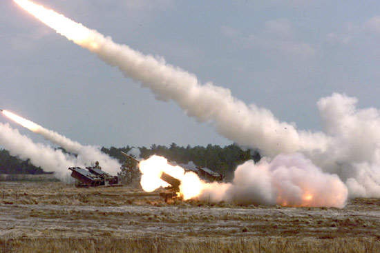 Three HIMARS stations firing rockets