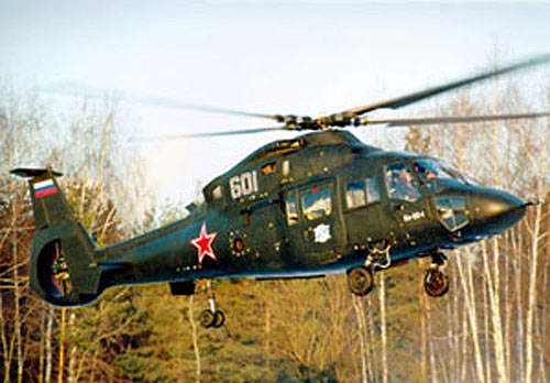 The Ka-60 has four-bladed main rotors with swept back tips and a multi-blade tail rotor.