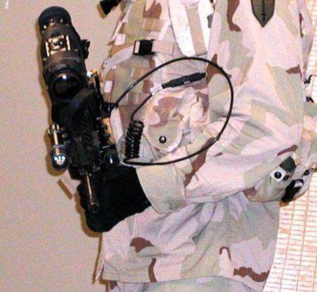Programmable control buttons on the weapon allow the soldier to carry out procedures without lowering the weapon. A quick disconnect weapon cable connects the weapon electronics to the hub.