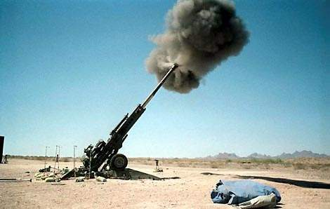 M777 39 calibre towed howitzer firing into the sky