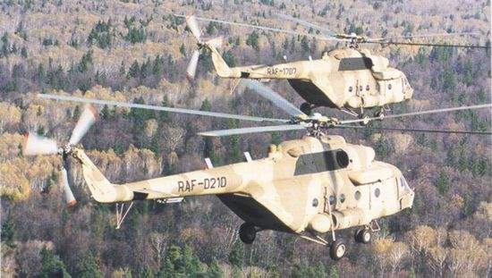 Two Rwandan Air Force Mi-17MDs on test flight prior to delivery.