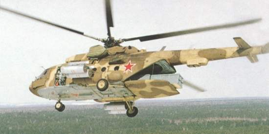 The Mi-17MD carrying cargo with the extended loading ramp.