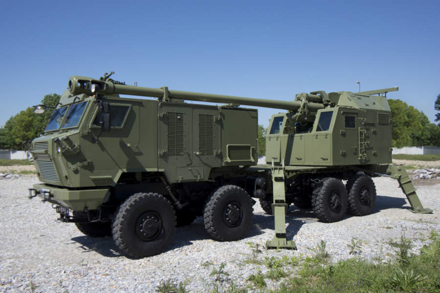A large military vehicle with multiple guns.