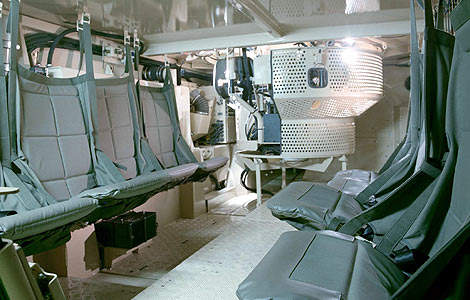 Interior of the 8x8. The seats are suspended from wall and ceiling mounts.
