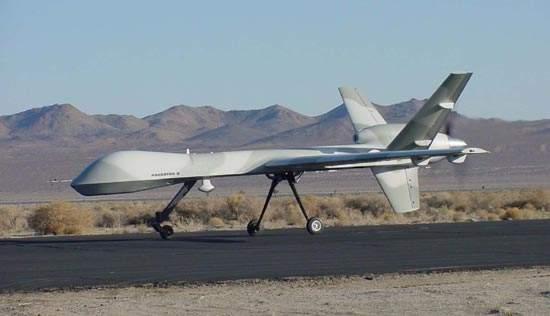 Predator B UAV landing on an airstrip