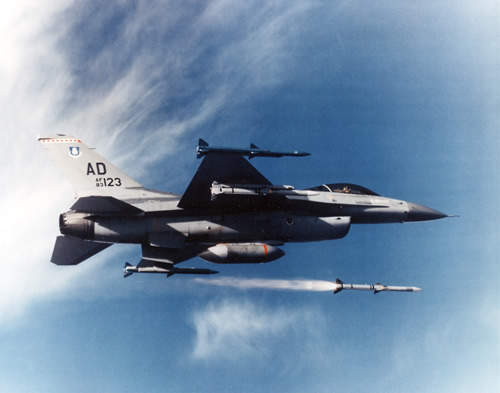 F-16 aircraft in flight firing a AIM-120 AMRAAM missile