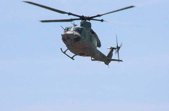 Descending Huey helicopter in flight