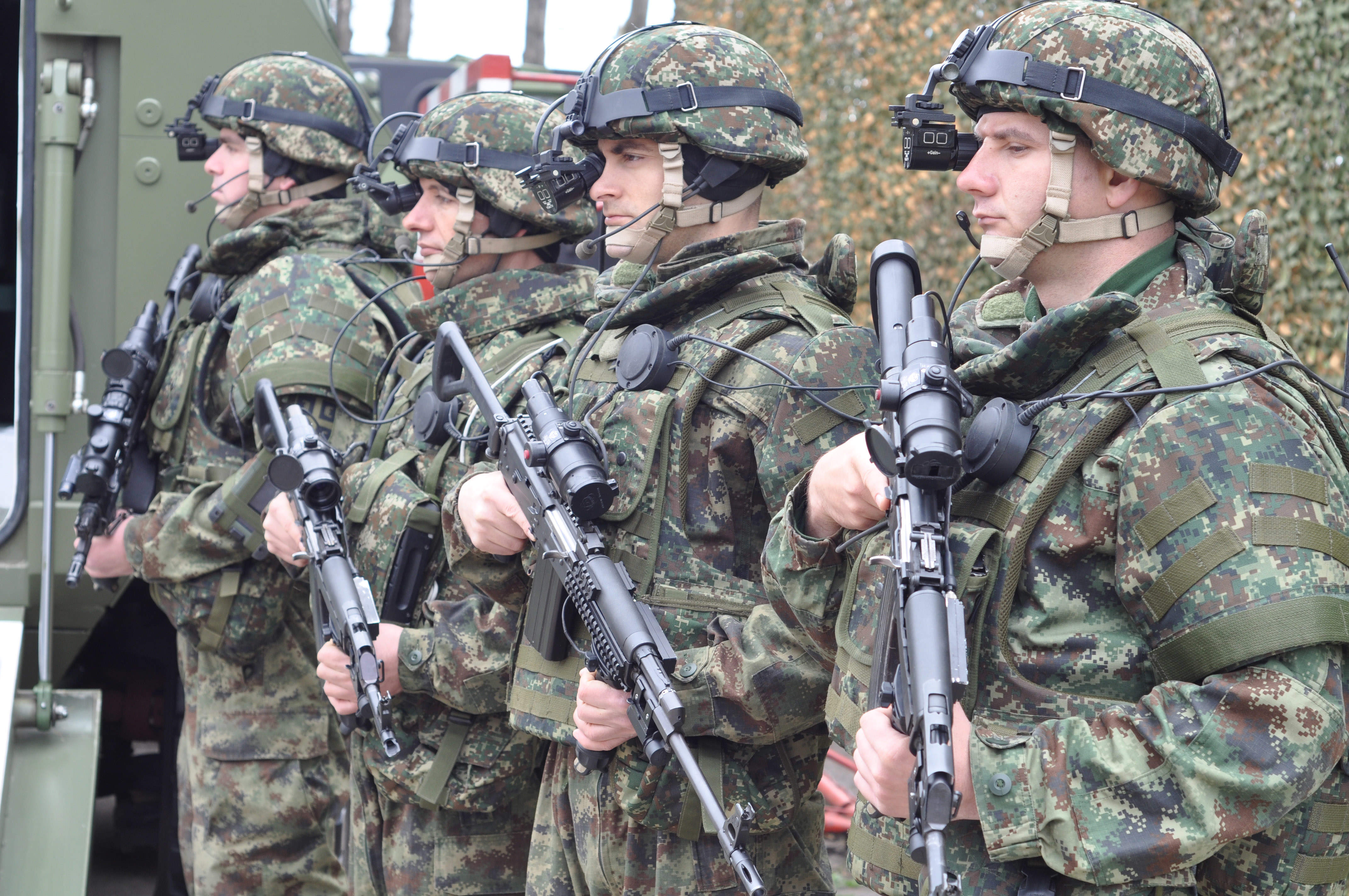 Four soldiers holding guns