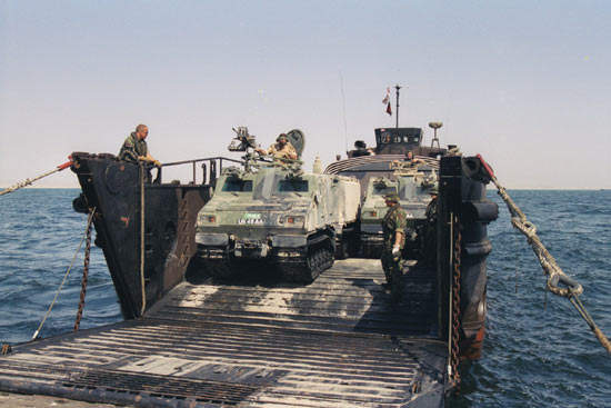 Two Vikings offloading at sea from an LCU Mk 9 landing craft.