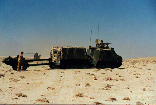 Viking pulling a Royal Marines 105mm light gun in Oman.