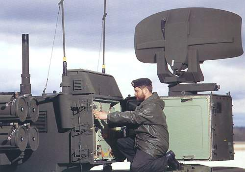 Solidier undertaking maintenance to the ADATS systems