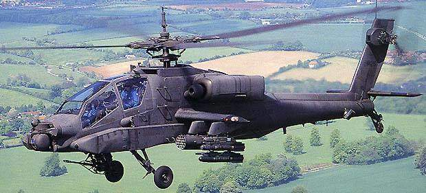 An AH-64 Apache Longbow armed with 16 Hellfire missiles, eight under each wing.