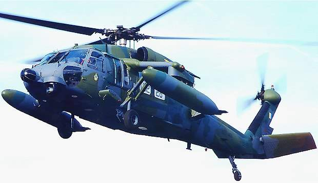 The highly capable Royal Brunei Air Force Black Hawk helicopter with radar, FLIR, and auxiliary fuel tanks is put through its paces.