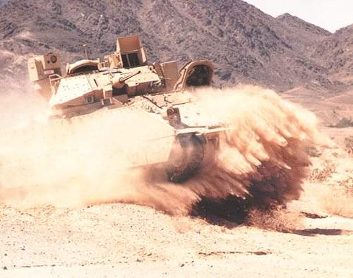 Sand submerged Bradley fighting vehicle in the desert
