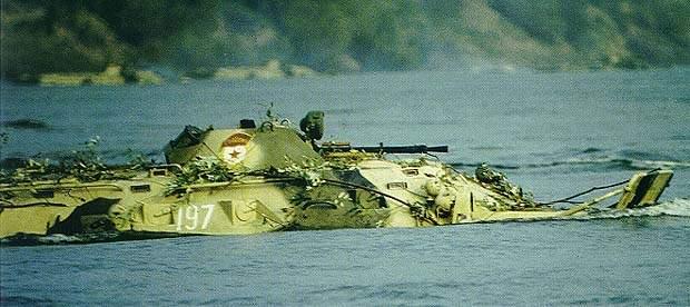 A BTR-80K Command APC fording a river