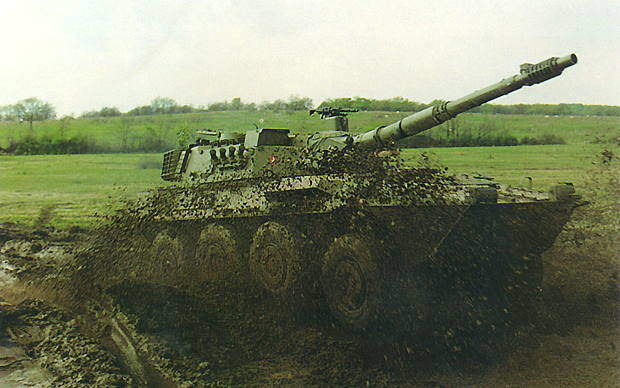 Centauro armoured fighting vehicles negotiating a muddy landscape