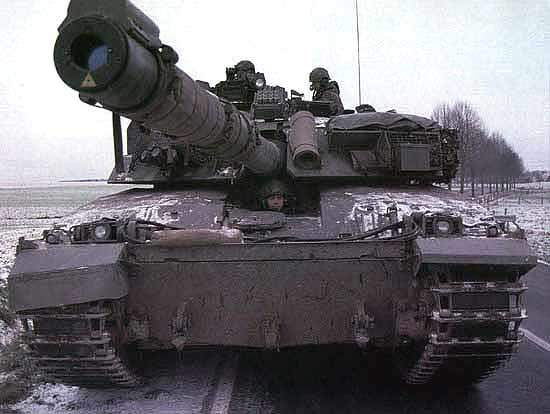 Challenger 1 tank being operated by a soldier on a road