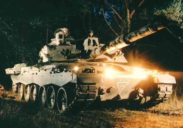 Two soldiers on a Challenger 2 battle tank during night time operations