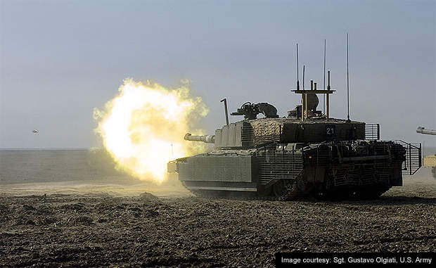 A British Army Challenger II main battle tank firing during a training exercise.