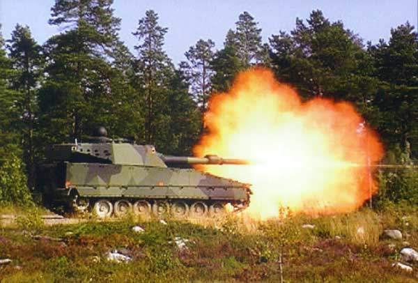 The CV90120-T tank firing using its 120mm gun