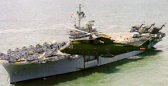 AW101 (EH101) Transport Helicopter flying next to a aircraft carrier