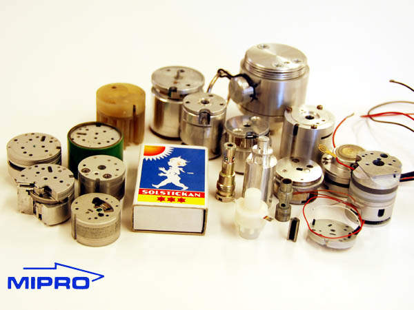A selection of fuze components and a matchbox.