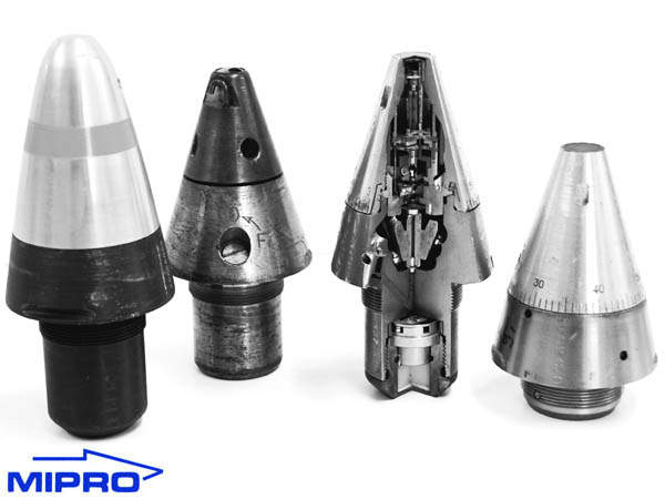 Four, large fuzes on a white background