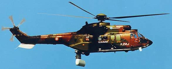 AS 532 Horizon helicopter flying against a blue sky