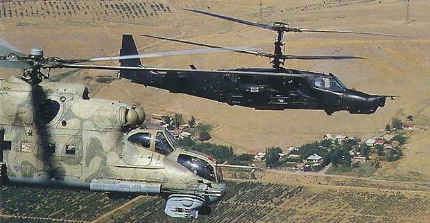 A Ka-50 Black Shark escorting an Mi-24 helicopter.