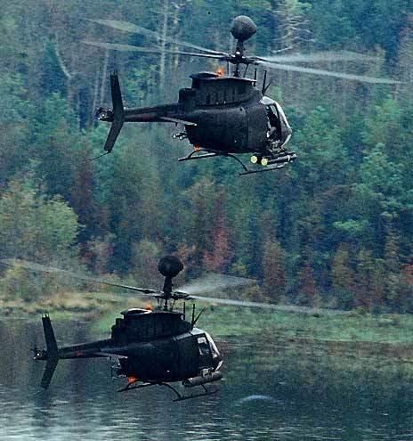Two Kiowa Warrior helicopters on patrol.