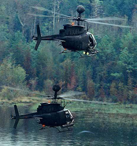 Two OH-58D Kiowa Warrior helicopters of the US Army on patrol.