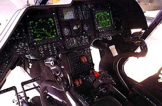 The cockpit of the Kiowa helicopter including video displays