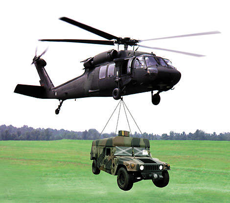 The LOSAT being air lifted by a helicopter