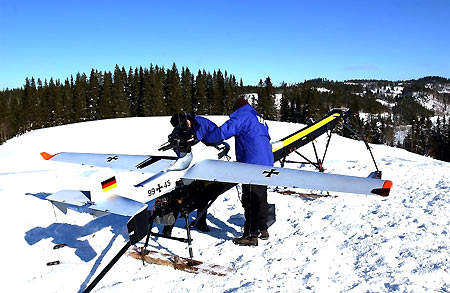 Preparation for catapult launch take-off in severe winter conditions in Norwegian mountainous terrain.