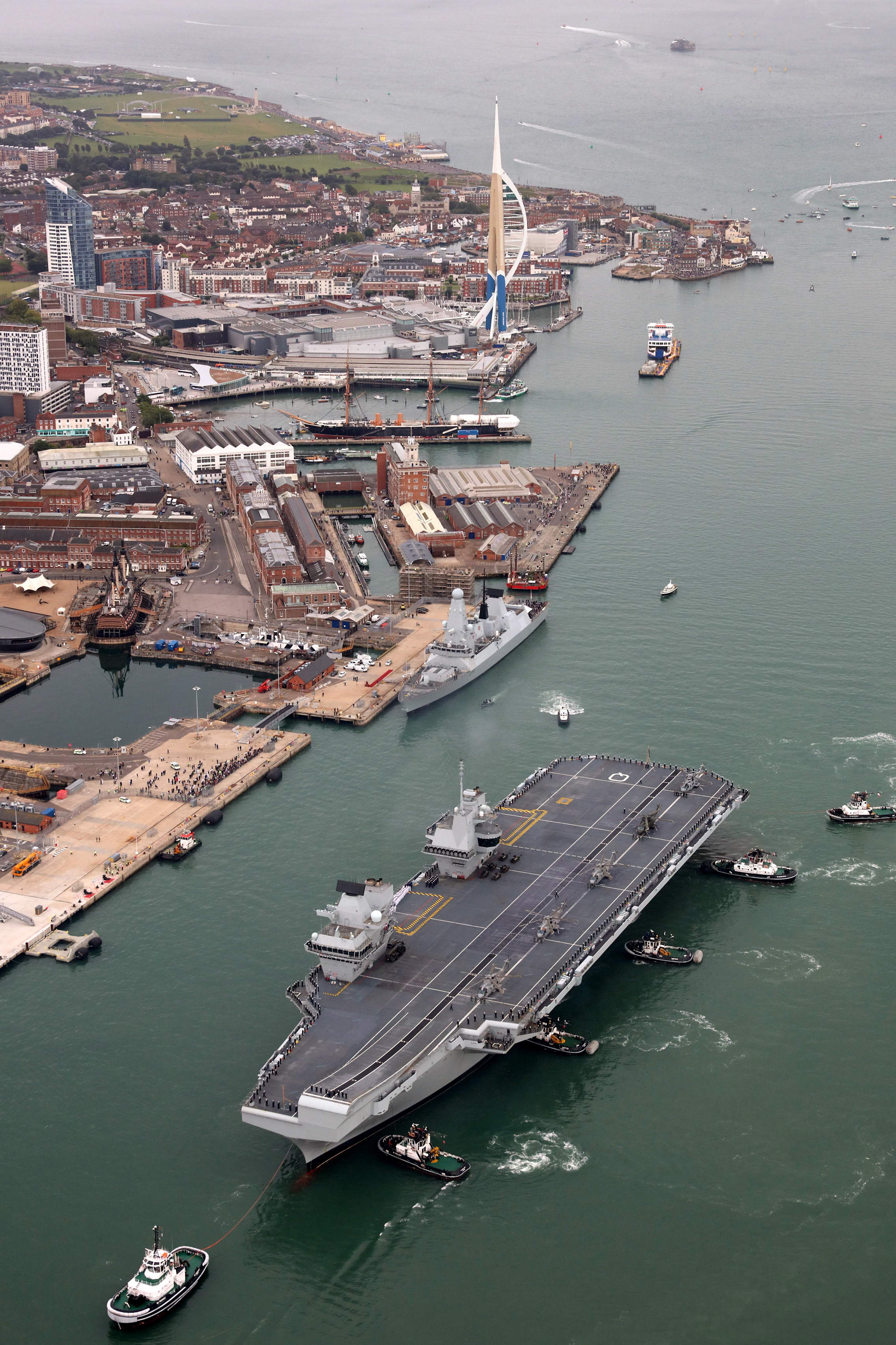 HMS Queen Elizabeth sails into her home port of Portsmouth for the first time