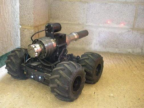 The COBRA MK2 E UGV is installed with a tilt-able, recoilless disrupter. Image courtesy of ECA Group.