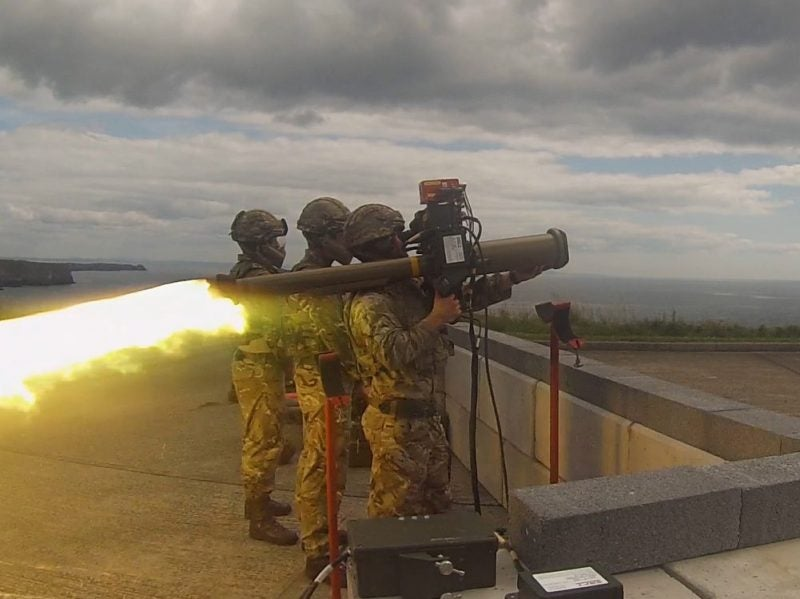 Missiles are fired from a shoulder launcher