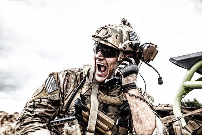 Soldier communicating with command during battle