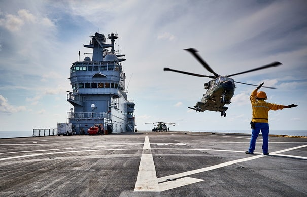 A Merlin Mk3A helicopter of 845 Naval Air Squadron (NAS) working from the flight deck of FS Mistral (French amphibious assault ship) in the Far East during Jeanne D'Arc 17. Two Merlin Mk3A helicopters and personnel 845 Naval Air Squadron were embarked on FS Mistral as part of the French Jeanne D'Arc 17 (JDA 17) task group in the Far East. 845 NAS, part of Commando Helicopter Force are based at RNAS Yeovilton, Somerset are embarked on the French Ship to provide aviation support for duration of the deployment. Around 60 Royal Navy and Royal Marines personnel exercised with their counterparts from other nations during the five-month annual French naval deployment to the Indian Ocean and Far East, including the first ever four-part maritime exercise involving France, Japan, the UK and US. The two-staged exercise named Forager Deux and Arc 17 took place in the sea and in the skies near to Japan, Guam, and Tinian, with the purpose of enhancing joint operating between the UK and international partners and deepening Defence cooperation. In addition to UK maritime personnel, the exercise also included two Royal Navy Merlin Mk3 helicopters from the UK's Commando Helicopter Force, which as part of a week-long practice assault moved 330 French, Japanese and American troops to and from Tinian.
