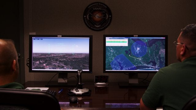 Two operators fly a UAS during one of the synthetic flight vignettes using a GBSAA system