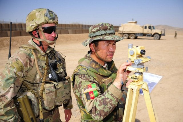 An Australian Army officer supervising ANA soldier on the aiming circle during Exercise Eagle's Flight in Afghanistan