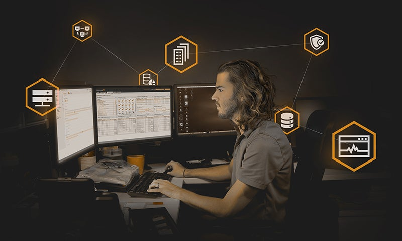 man sitting at government computer accessing intelligence